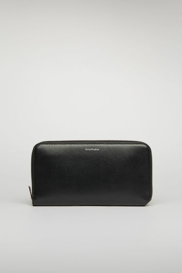 Acne Studios Fluorite S black continental wallet is crafted from smooth leather and fitted with 12 card slots, two notes sleeves and a central zip pocket for coins.