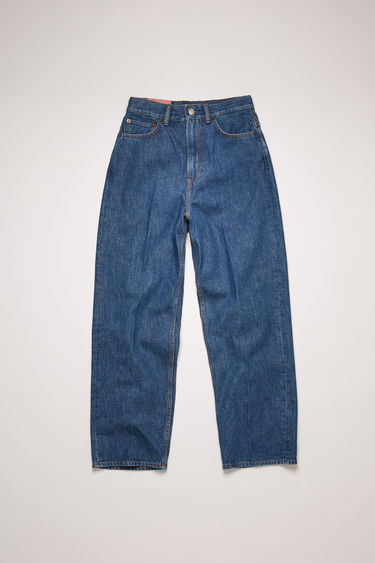 Acne Studios 1993 Dark Blue Trash jeans are crafted from rigid denim that's stone washed for a vintage appeal. They're cut to a super high-rise silhouette with tapered legs that crop above the ankles.