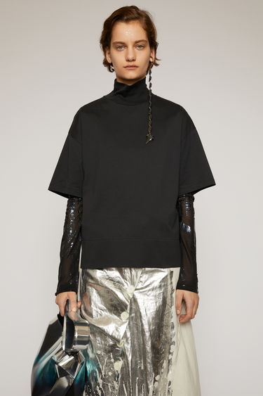 Acne Studios black t-shirt is cut to a boxy shape with an oversized fit and shaped with a mock neck.