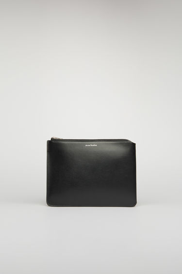 Acne Studios black document holder is crafted from soft cow leather and accented with a silver-tone zip closure and foil branding on the front.