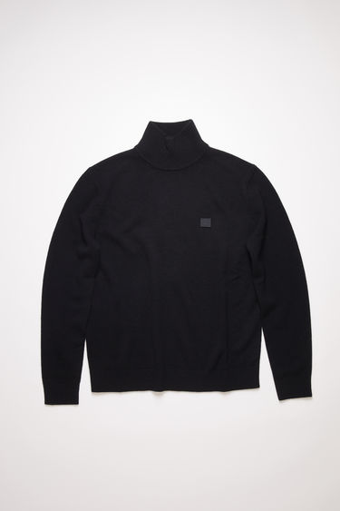 Acne Studios black turtleneck sweater is made from wool with a face logo patch and ribbed details.
