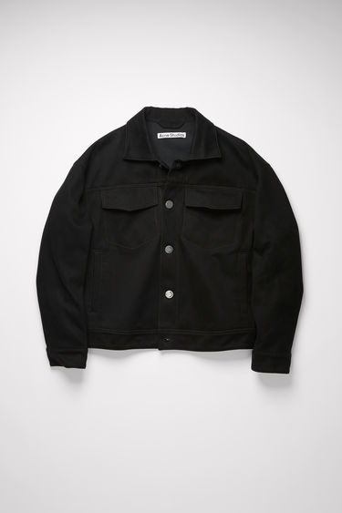 Acne Studios black jacket is crafted from cotton twill to a boxy silhouette with dropped shoulders and features two chest flap pockets, two side pockets and silver-tone metal button closure.
