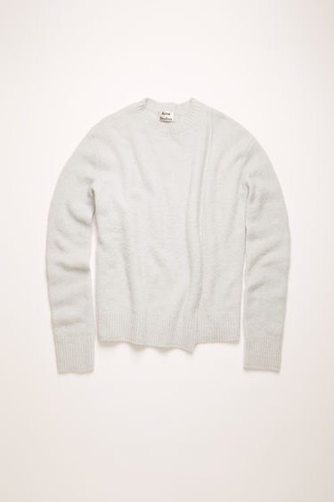 Acne Studios ice blue sweater is crafted from an alpaca blend with hints of wool for a soft hand feel. It's shaped with a crew neck and finished with a stepped hemline.
