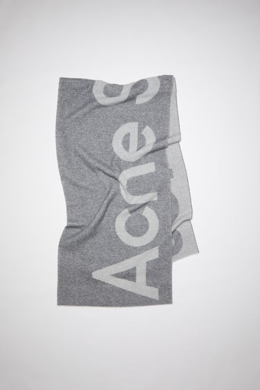Acne Studios grey oversized scarf is made of a soft recycled wool blend featuring bold logo lettering on both sides.