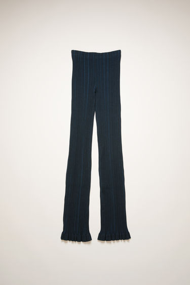 Acne Studios midnight blue trousers are crafted from mercerised-cotton jersey and features an irregular ribbed pattern. They're shaped in a skinny-leg shape and finished with a frilled hem.