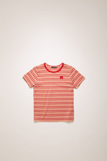 Acne Studios poppy red striped t-shirt is shaped with a round neck and short sleeves and finished with a face-embroidered patch on the chest.