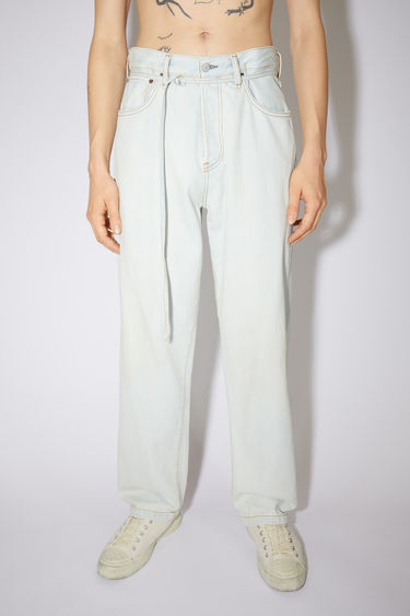 Acne Studios white jeans are made from rigid denim with a deep rise and a loose leg.