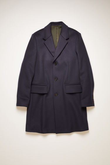 Acne Studios coat is crafted from wool-blend to a single-breasted silhouette and has wide notched lapels, two front flap pockets and three-button closure.