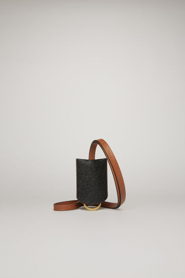 Acne Studios launches a collection of bags and accessories with Mulberry. The Lanyard Scotch grain is an encased key ring with a pebble grain finish and then accented with a co-branded lanyard.
