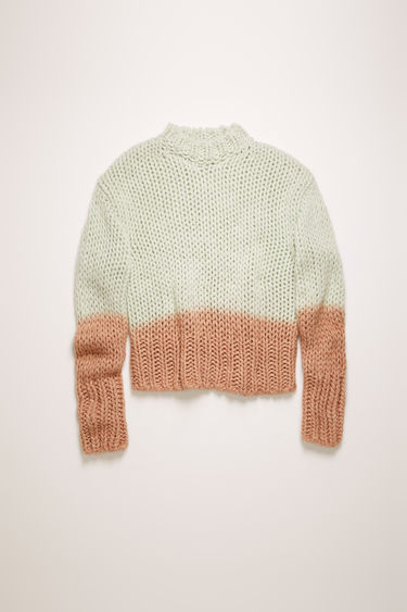 Acne Studios pastel green sweater is crafted from a soft alpaca and wool blend, and dip-dyed at the hem and cuffs for a two-tone effect.