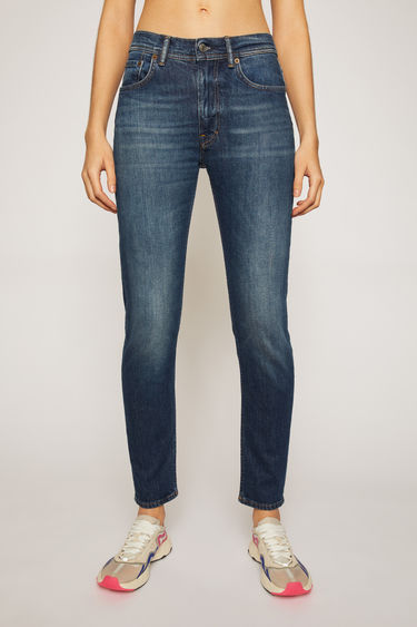 Acne Studios Melk Dark blue jeans are crafted from comfort stretch denim that's washed to give a worn-in appeal. They're cut to a high-rise waist with a slim, tapered leg and accented with subtle whiskering and fading.