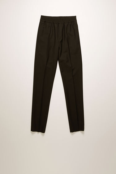 Acne Studios Ryder L Wo Mh black trousers are crafted from a lightweight wool and mohair blend and shaped with slim legs with a mid-rise elasticated waistband.
