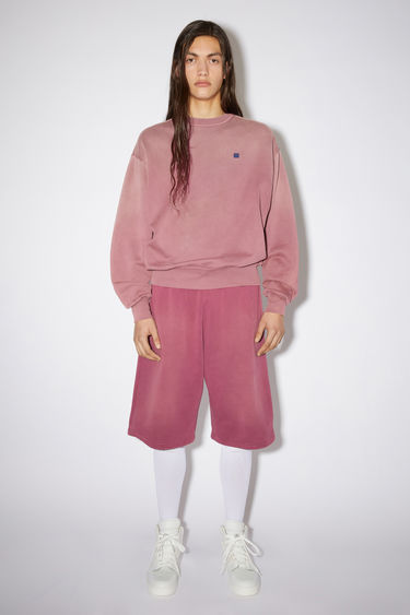 Acne Studios dark mauve relaxed bubble fit sweatshirt is made of organic cotton with a contrasting face patch and embroidery.