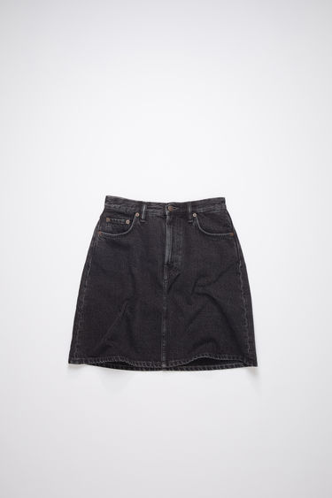 Acne Studios black rigid denim skirt is made of cotton, featuring a stone washed, black overdyed denim.