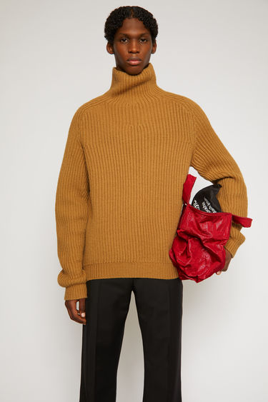 Acne Studios hazel beige sweater is knitted from thick wool yarn to a ribbed design and shaped with a roll neck and raglan sleeves.