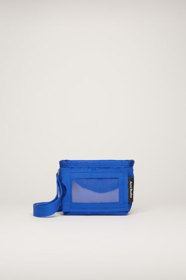 Acne Studios deep blue pouch is crafted to a boxy shape with a transparent card pocket on front and features a long detachable lanyard