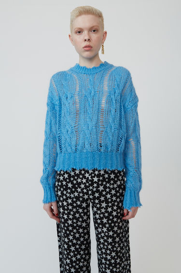 Acne Studios sky blue sweater is loosely knitted in cable-knit pattern and finished with frayed trims.
