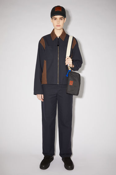 Acne Studios navy/dark brown lightweight workwear-inspired jacket is made of an organic cotton twill and features a contrasting collar and side panels.