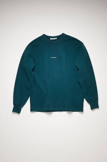 Acne Studios deep petrol sweatshirt is made from organically grown cotton that's garment dyed for a soft handle and features a raised logo lettering on front.