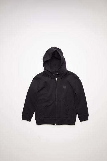 Acne Studios children's black hooded sweatshirt is made of organic cotton with a face logo patch and ribbed details.