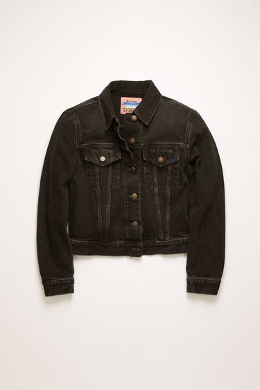 Acne Studios 1999 Vintage Black jacket is crafted from rigid denim that's stonewashed to give a worn-in appeal. It's cut to a slim silhouette with chest patch pockets and accented with tobacco stitching and logo-embossed metal buttons.