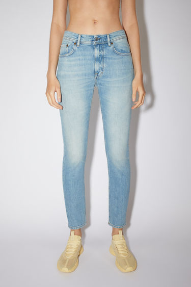 Acne Studios light blue jeans are made from comfort stretch denim with a high rise and a slim, tapered leg.