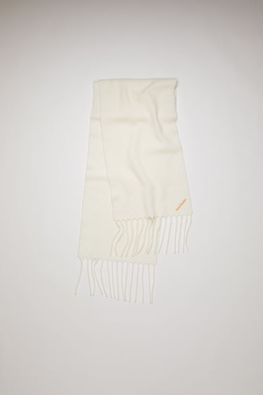 Acne Studios white scarf is crafted from soft boiled wool-blend and finished with fringed trims and an embroidered logo.
