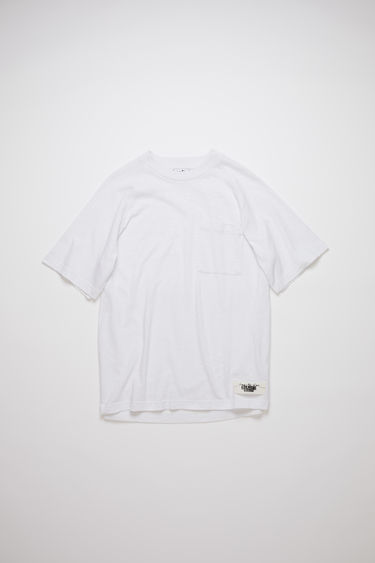 Acne Studios optic white short sleeve raglan t-shirt is made of a cotton blend with a logo label at the bottom side.