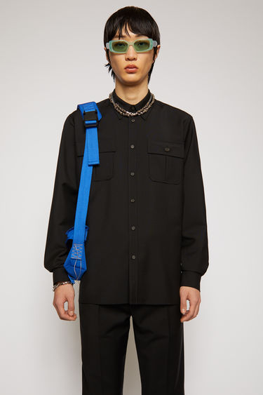 Acne Studios black shirt is made from wool and mohair that has a subtle lustrous sheen. It's cut for a relaxed silhouette and has a straight hem and a pair of buttoned patch pockets at the chest.