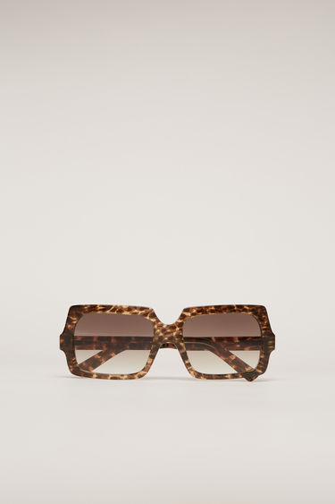 Acne Studios George Large leopard/brown degrade sunglasses are crafted from acetate to a chunky, squared silhouette and then complete with discreet logo lettering at the temple.