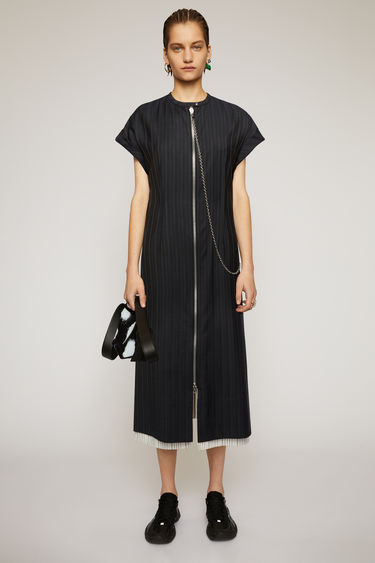 Acne Studios navy blue dress is cut to a relaxed silhouette from two different pinstriped suitings and accented with silver-tone metal hardware.