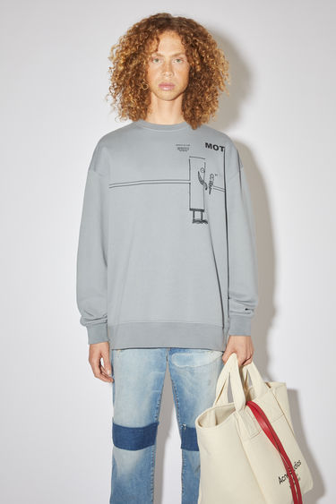 Acne Studios fog grey oversized sweatshirt is made of cotton with a printed design on the front.