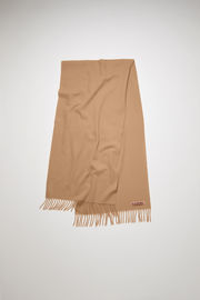 Acne Studios Canada Nr New camel brown scarf is crafted from pure wool and finished with fringed edges and a label across one corner.
