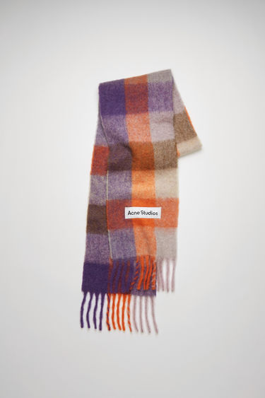 Acne Studios lilac/orange/brown checked scarf is spun from alpaca, wool and mohair yarns to a wide dimension and features a stitched logo patch above the fringed edges.