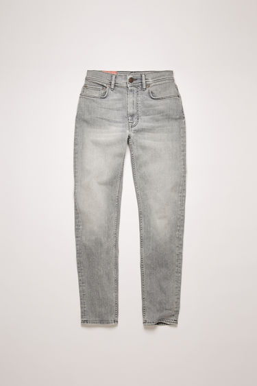 Acne Studios Melk Stone Grey jeans are crafted from comfort stretch denim that's washed to give a worn-in appeal. They're cut to a high-rise waist with a slim, tapered leg and accented with subtle whiskering.