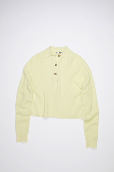 Acne Studios lemon yellow polo sweater is made of a soft, rib knit with a relaxed fit.