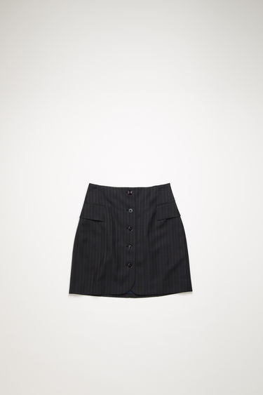 Acne Studios navy blue pinstripe skirt is crafted from wool to a high-rise silhouette and features two front flap pockets and a horn-effect buttoned placket.