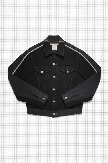 Acne Studios Repurposed black/black panel jacket is crafted in black rigid denim and black wool fabric. Shaped in a boxy silhouette with dropped shoulders and finished with buttoned patch pockets, and detachable sleeves.