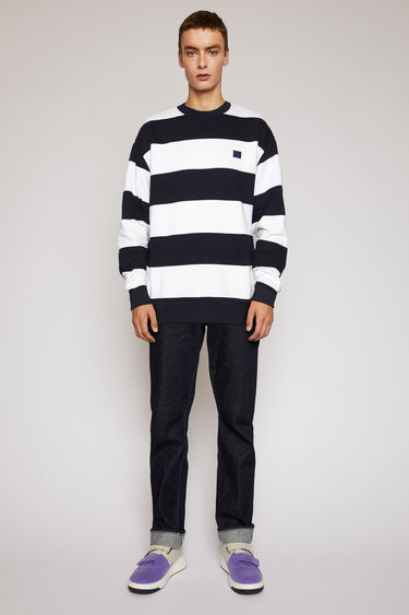 Acne Studios navy/white fleece sweatshirt is patterned with block stripes and finished with a face-embroidered patch on the chest.