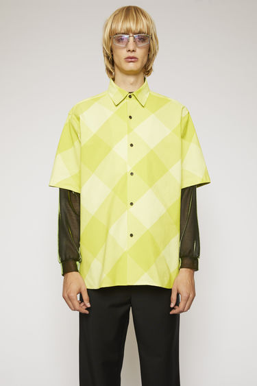 Acne Studios soft yellow/sharp yellow shirt is crafted from lightweight cotton with a vichy check pattern and shaped to a boxy fit with short sleeves.