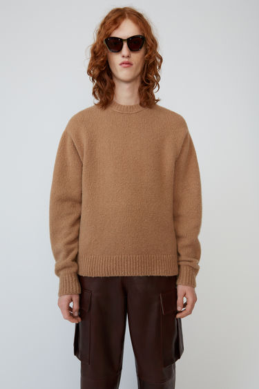 Acne Studios light brown sweater is knitted from soft wool-blend and completed with a ribbed crew neck, cuffs and hem.