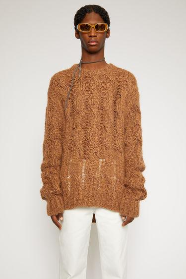 Acne Studios brown/burgundy sweater is loosely knitted with different shades of yarn in a cable-knit pattern and finished with ribbed trims along the neck, cuffs and hem.