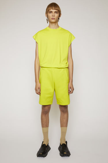 Acne Studios sharp yellow shorts are made from heavyweight brushed jersey and are shaped to a relaxed fit with an elasticated drawstring waistband