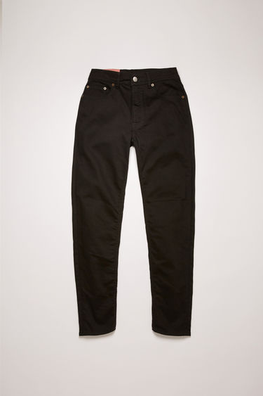 Acne Studios Blå Konst Melk stay black are slim, tapered fit 5-pocket jeans with a cropped length and high waist.