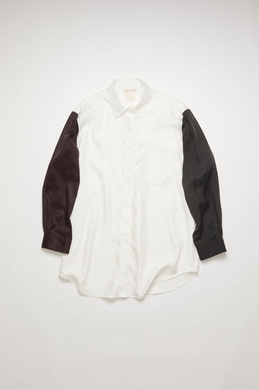 Acne Studios off white/burgundy shirt is crafted in three different colors and repurposed materials. Shaped to sit loose around the shoulders and a slight oversized fit.