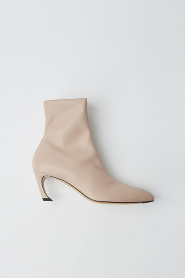 Acne Studios dusty pink ankle boots crafted from soft lamb leather with pointed toe and paired with a curved midi-heel.