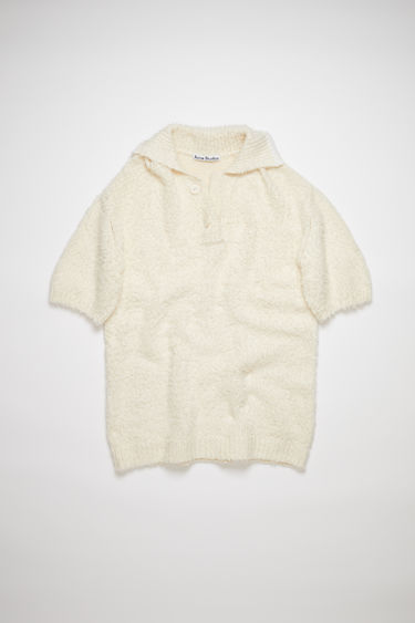 Acne Studios cream beige brushed cotton polo sweater is made of a cotton blend with an oversized fit.