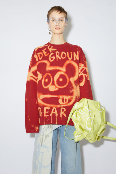 Acne Studios ecru beige crew neck sweatshirt is made of cotton with an all over bleached print.