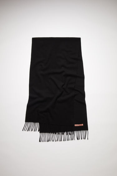 Acne Studios Canada Nr New black scarf is crafted from pure wool and finished with fringed edges and a label across one corner.