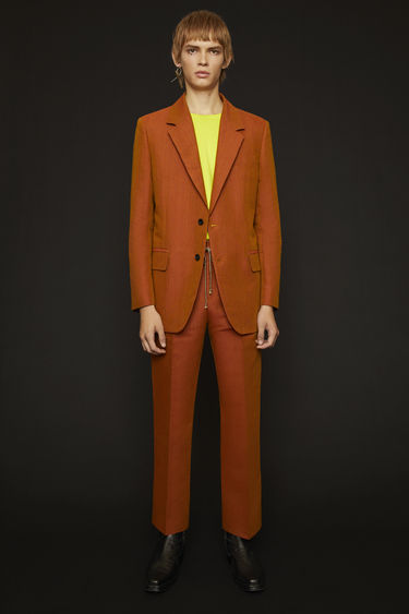 Acne Studios apricot orange suit jacket is crafted from a viscose and linen blend suiting featuring a subtle iridescent effect and has structured shoulders and neat darts down the front.